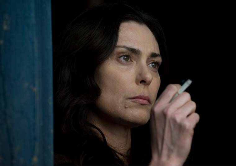 Michelle Forbes smoking a cigarette (or weed)