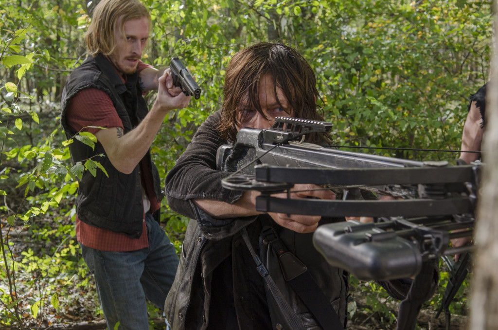 Dwight sneaks up behind Daryl